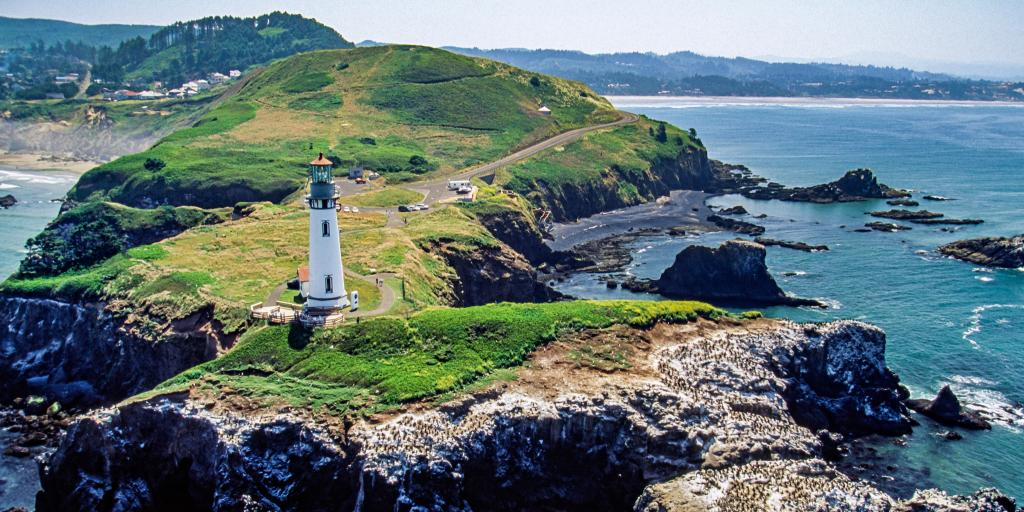 Aerial image of Yaquina Head Lighthouse on the rugged coastline in Oregon, USA