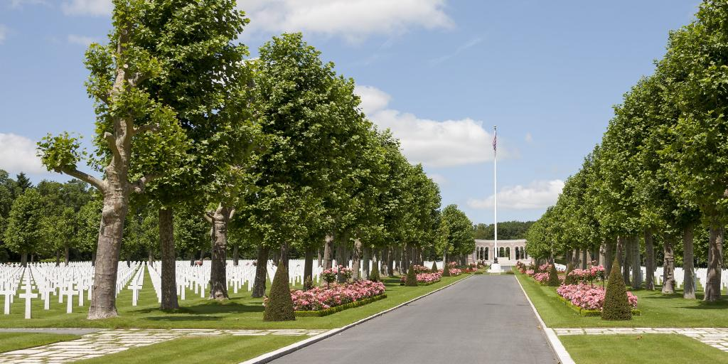 The boulevard of Oise Aisne American Cemetery, France, with rows of crosses either side and the monument visible at the end