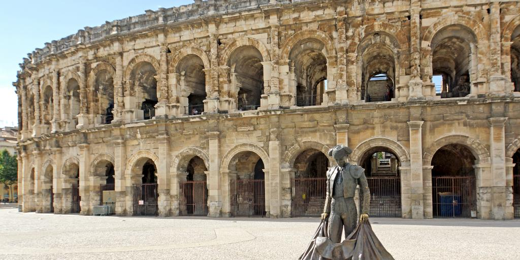 Statue of a bullfighter in front of Arles Amphitheatre in France