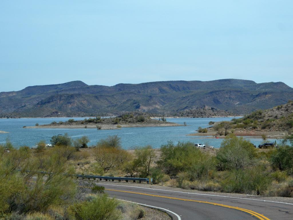 A scenic view of Lake Pleasant Park recreation area in Phoenix, Arizona from the road on a fine day