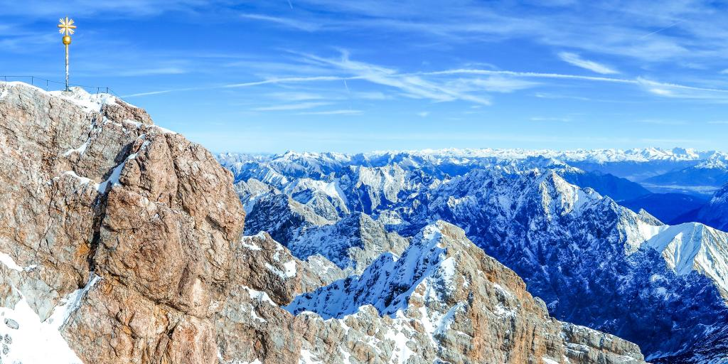 The brown granite peak at Zugspitze with many snow capped mountain peaks in the background