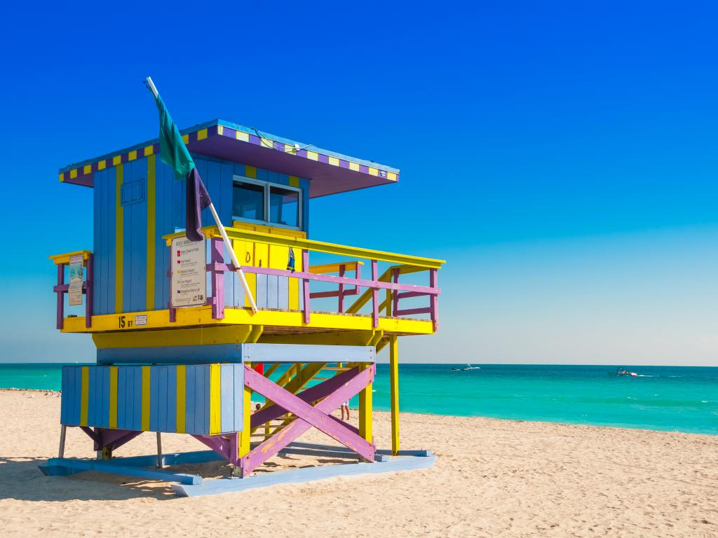 Colorful lifeguard tower on South Beach in Miami looking out to a perfectly clear sky and gorgeous sea