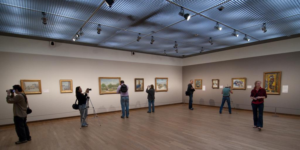 Photographers snap pictures of the artwork in the Van Gogh Museum, Amsterdam