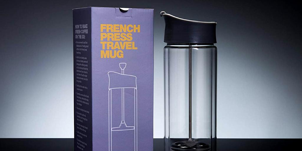 The clear travel cafetiere by Koala Koffee next to the purple box it comes in