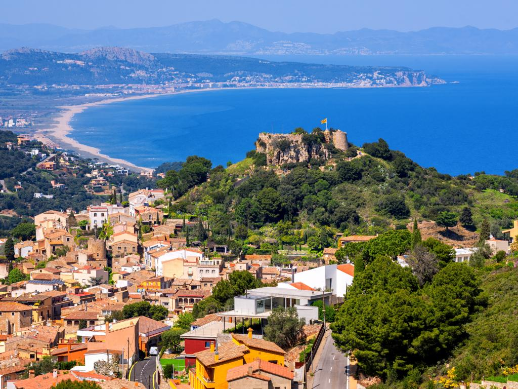 Begur Old Town and Castle overlooking Mediterranean Sea and the Pyrenees mountains