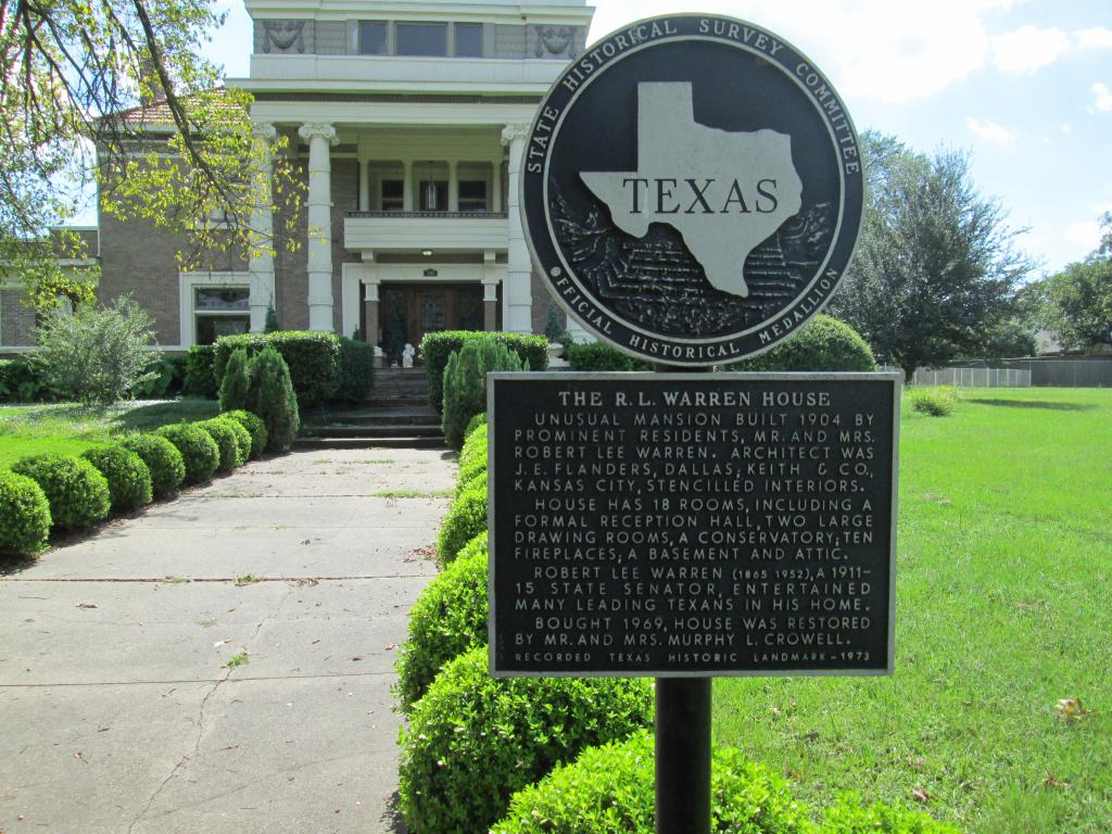 The 18-room mansion of R. L. Warren House and its historical medallion in Terrell, Texas.