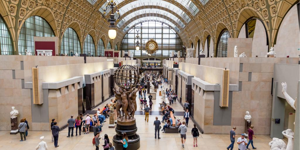 People walking around inside the Musee D'Orsay in Paris