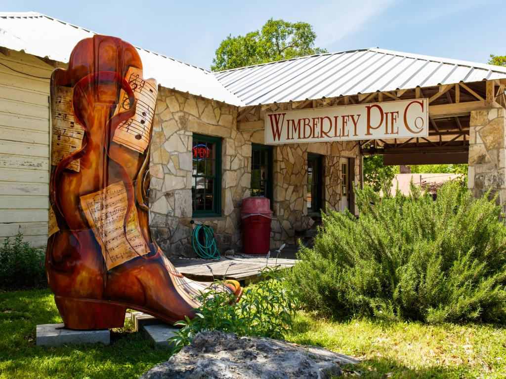 The Wimberley Pie Company store with a giant cowboy boot in Wimberley, Texas