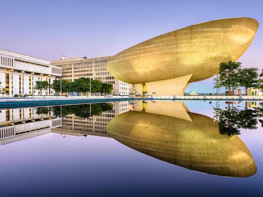 The Empire Plaza at the Egg reflecting from the water on a fine day.