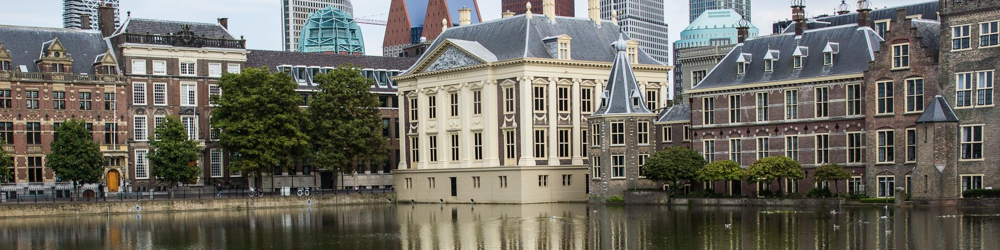 Old and new buildings reflect on the water in the Hague, Holland