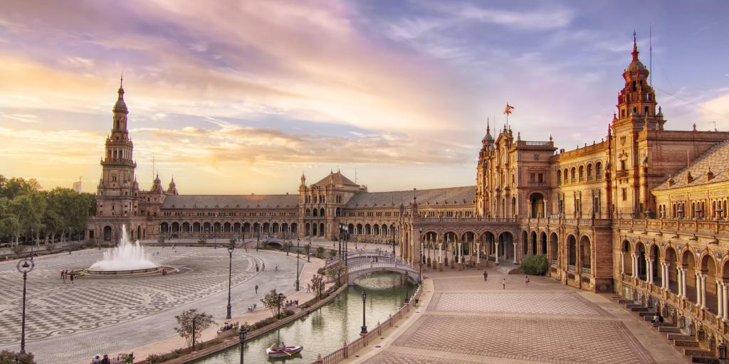 The sun sets over Plaza de Espana in Seville, Spain