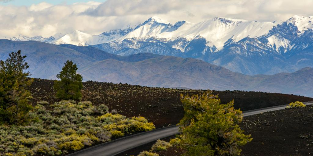 Craters of the Moon National Monument and Preserve in Idaho, with snow capped mountains in the distance