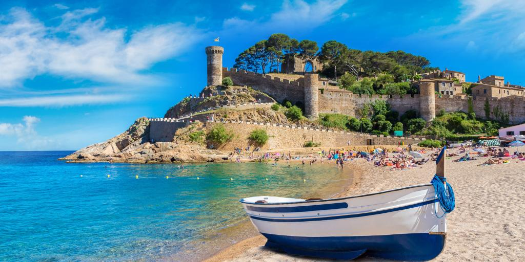 Beach at Tossa de Mar and fortress in a beautiful summer day - Costa Brava, Catalonia