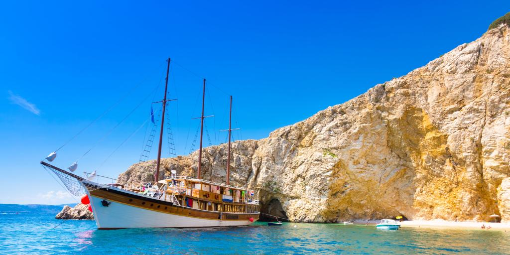 Vintage sailing boat anchored in an idyllic bay on Krk island in Croatia in Mediterranean sea