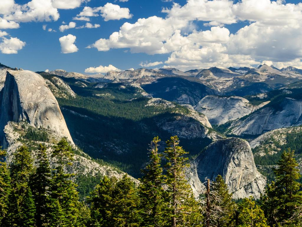 A panoramic view of the granite dome in Yosemite Half Dome in Yosemite National Park on a cloudy day.