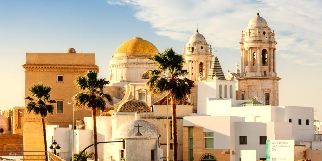 The yellow dome and white front towers of Cadiz Cathedral, Spain, on a sunny day