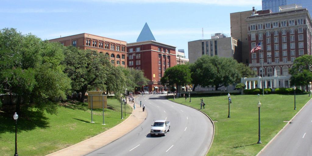 A car driving through Dealey Plaza in Dallas