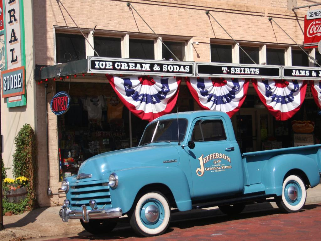 The classic blue Chevy pickup outside the Jefferson General Store in Jefferson, Texas.