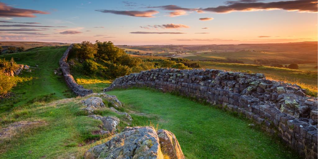 The sun sets over Hadrian's Wall in the beautiful Northumberland National Park