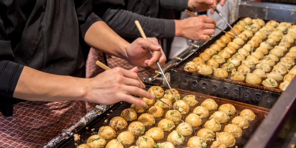 Chefs making takoyaki in Osaka
