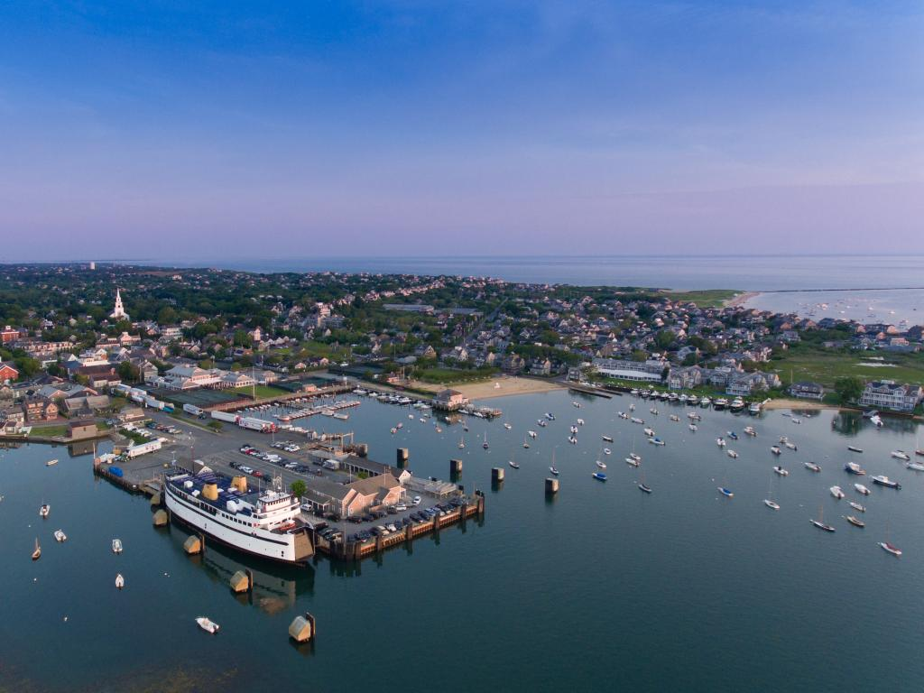 An aerial view of the Nantucket Island Harbor with sailboats and houses.