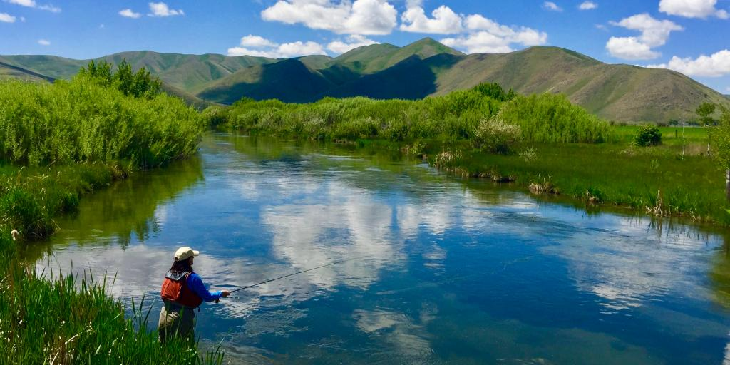 Woman fishing in a creek near Sun Valley, Idaho