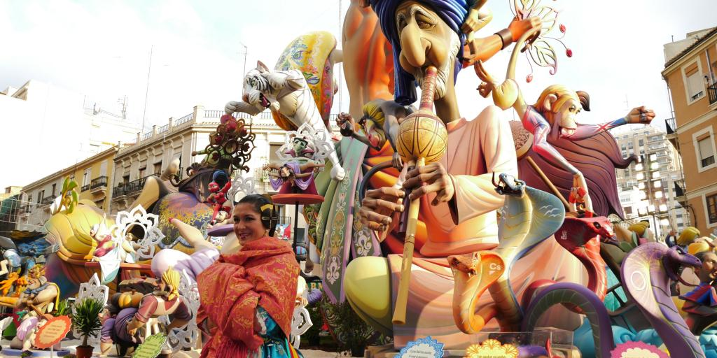 Ninot puppets moving down the street at the Las Fallas festival in Valencia