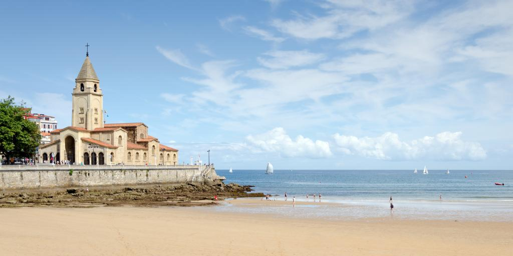 Looking out across San Lorenzo Beach in Gijon towards the peninsula of Santa Catalina