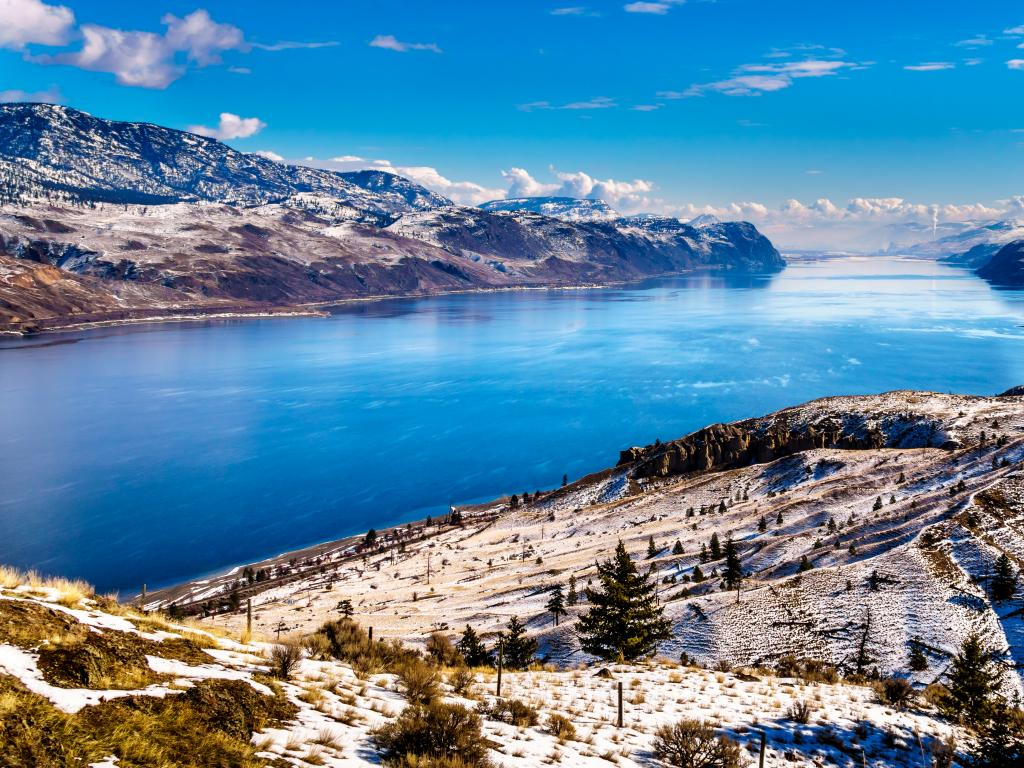 A winter view of Kamloops Lake and its surrounding mountains