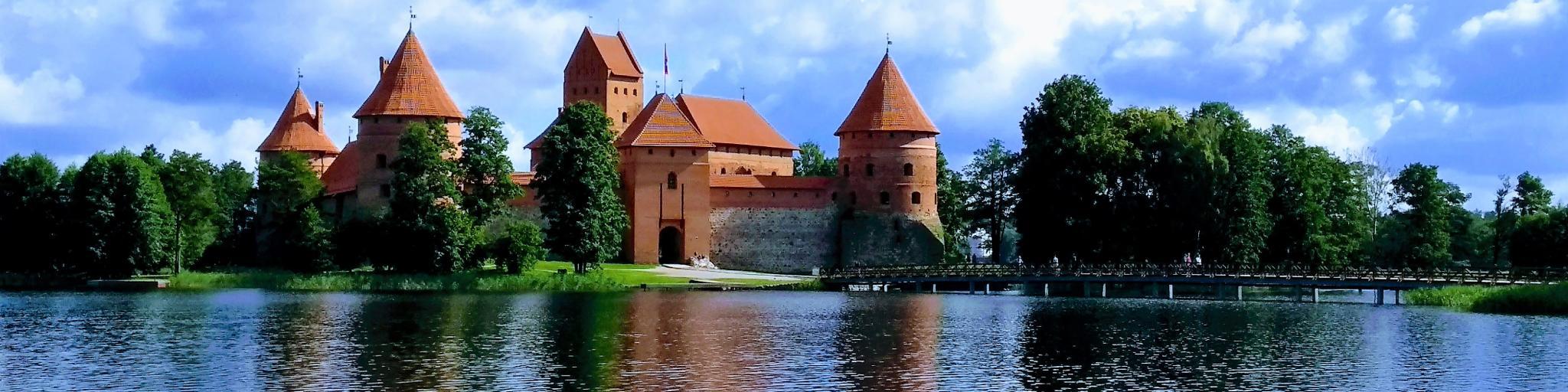 Trakai Castle and its reflection on the beautiful Lake Galvė