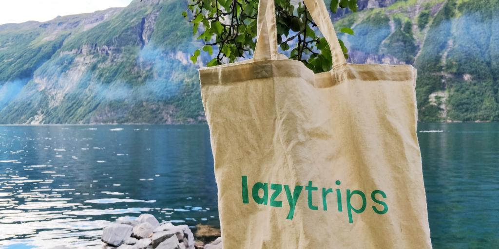LazyTrips tote bag against the backdrop of a Norwegian fjord