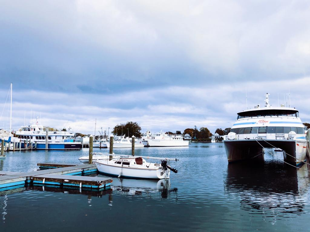 A harbor at Hyannis,Massachusetts with boats docked during daytime.