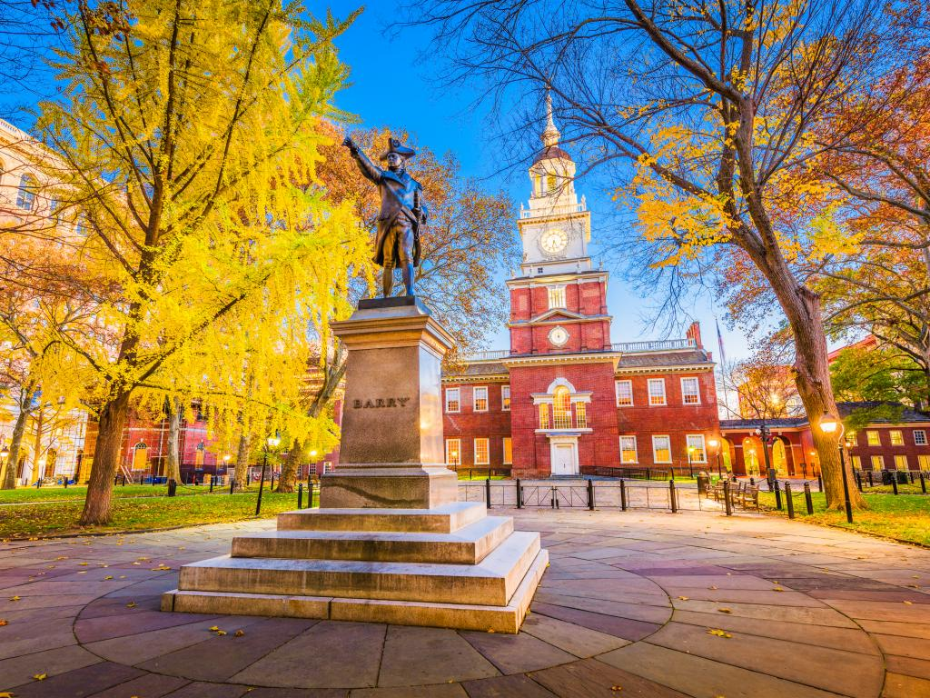 The Independence Hall and statue of Commodore John Barry in Philadelphia, Pennsylvania.