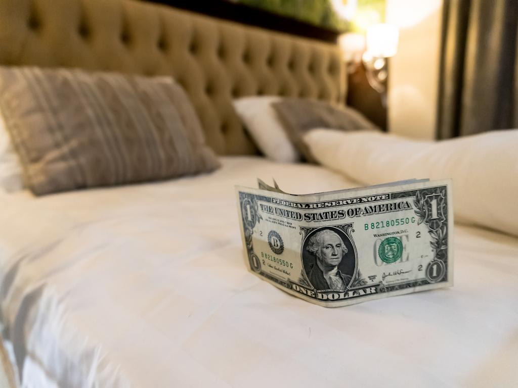 A tip left on the bed for the hotel maid in a hotel room in the United States