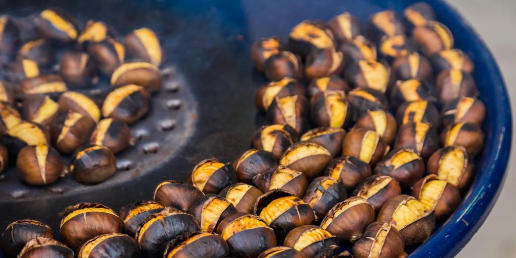 A close up of chestnuts cooking