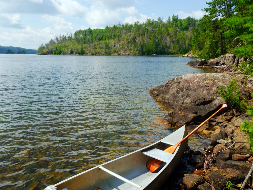 Canoe and oar on the rocks of Knife Lake in Quetico Provincial Park, Canada