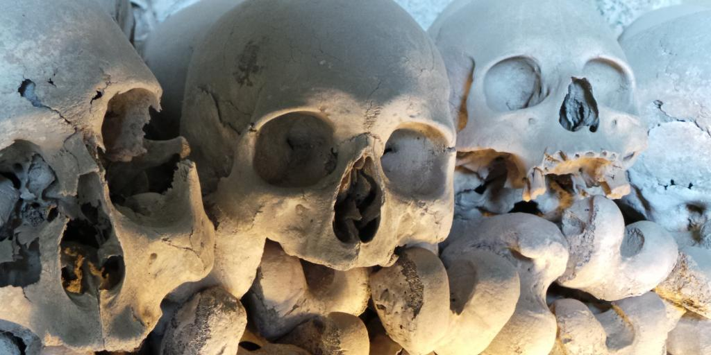 Piles of human skulls on display in the Fontanelle Cemetery burial ground