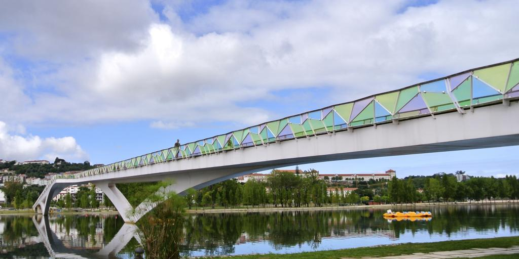 The colourful Pedro e Ines bridge in Coimbra crosses the Rio Mondego