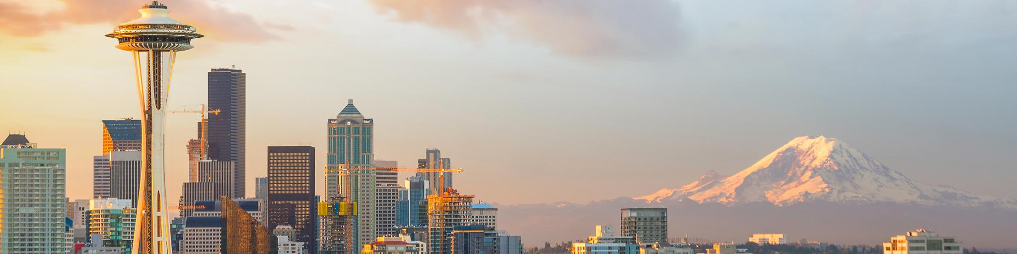 A panoramic view of downtown Seattle Skyline and the mountain at sunset on a fine day in Seattle, WA.