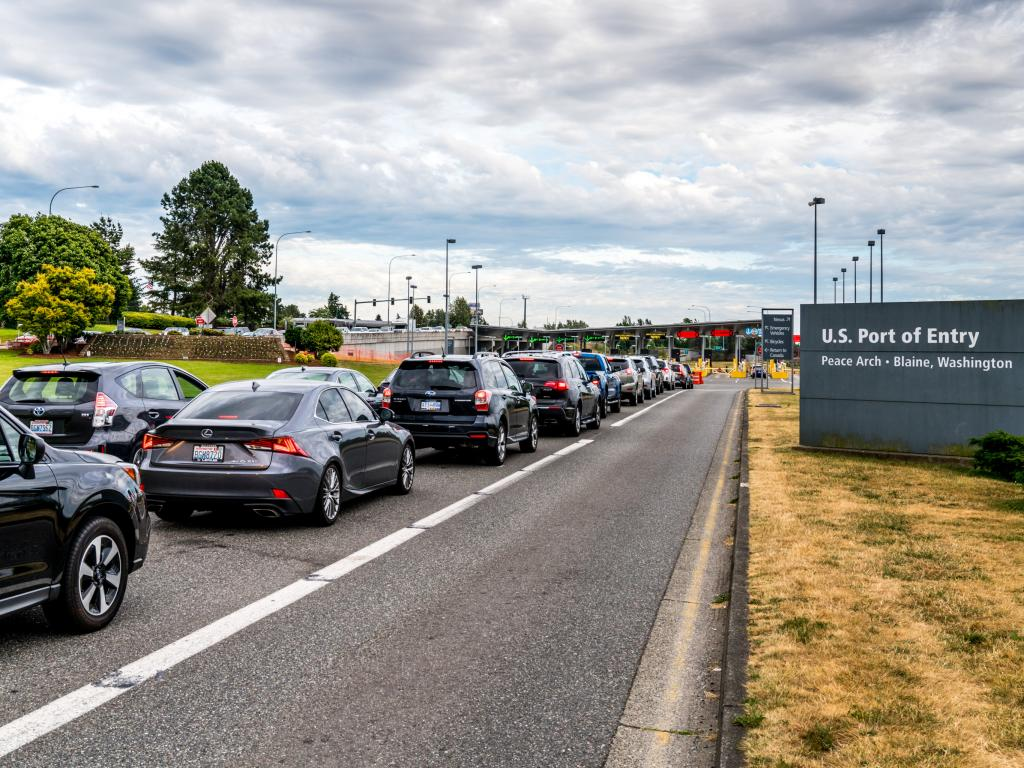 Queue of cars at the Canada - US Peace Arch border crossing
