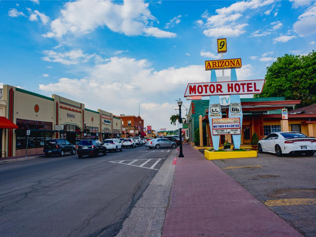 A busy street of the famous Route 66 at Williams with cars and establishments on each side of the road on a sunny morning