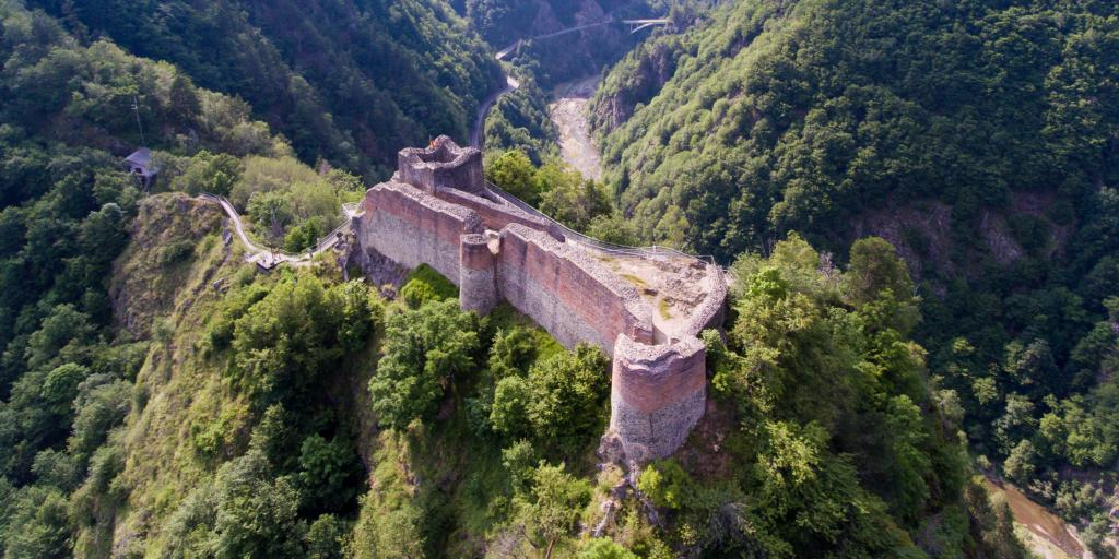 The Poienari Castle ruins on the Transfagarasan Road surrounded by lush green trees