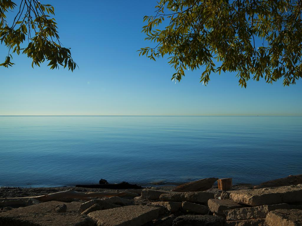 The calm water of Lake Ontario at dusk in Missisauga near Toronto.