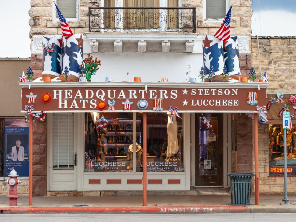 Headquarters Hats storefront selling Stetson hats and Lucchese boots in the old Fredericksburg bank building.