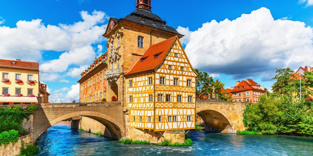 View of the yellow timbered City Hall building in Bamberg, Germany, with the river below it