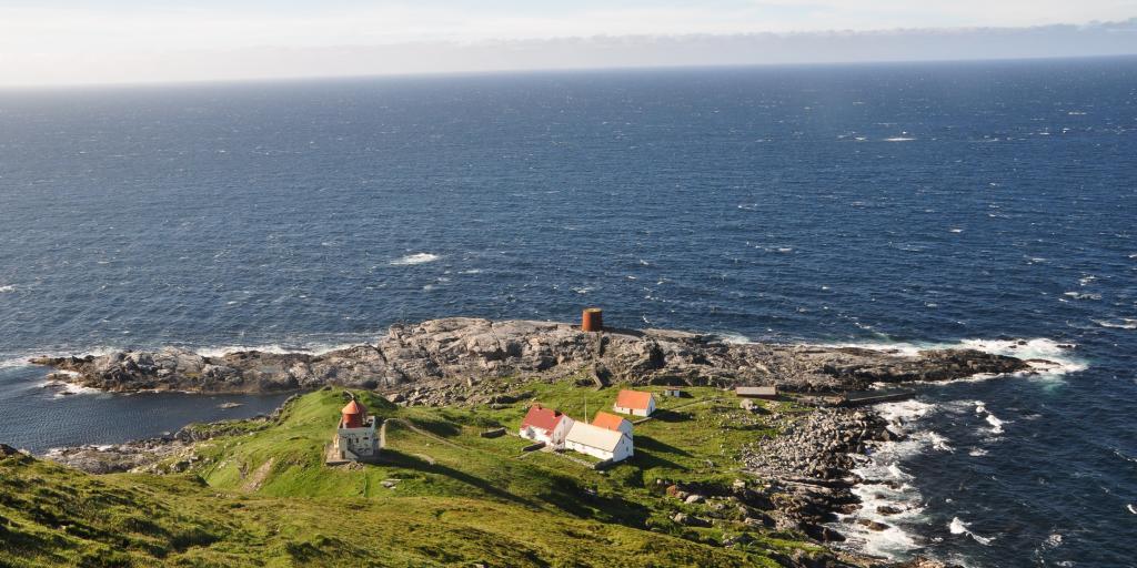 Waves crash onto the coast of Ronde Island near Alesund, Norway