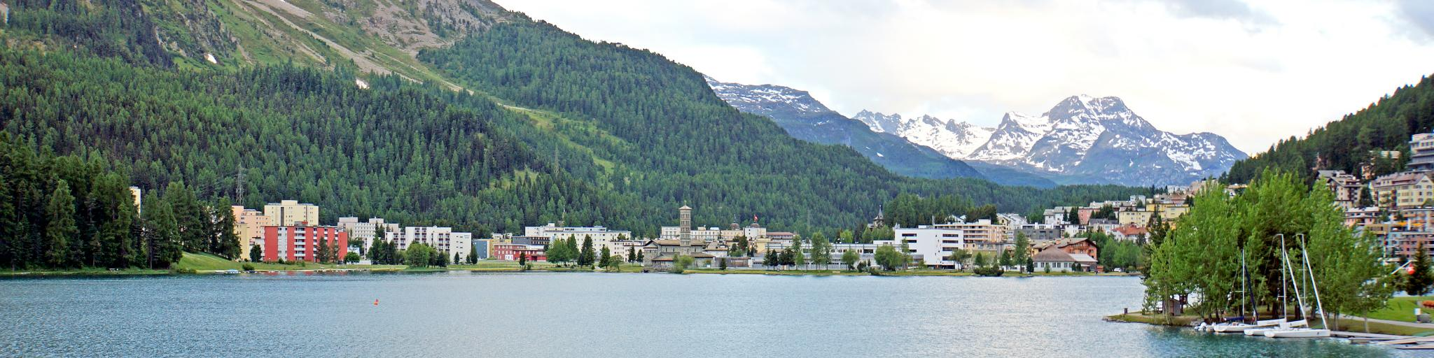 A view of Lake St Moritz, Switzerland, with the snow-capped Swiss Alps in the background