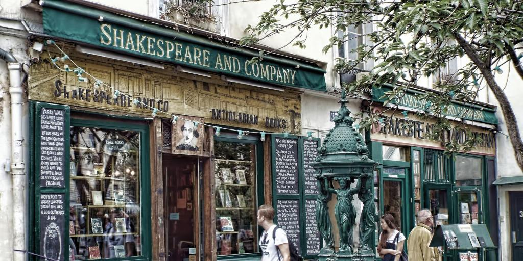Passers-by look in the window of Shakespeare and Company bookshop