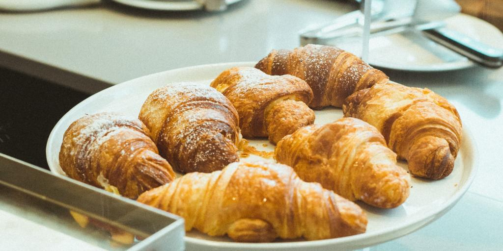 A plate of freshly baked croissants in a cafe in Tokyo