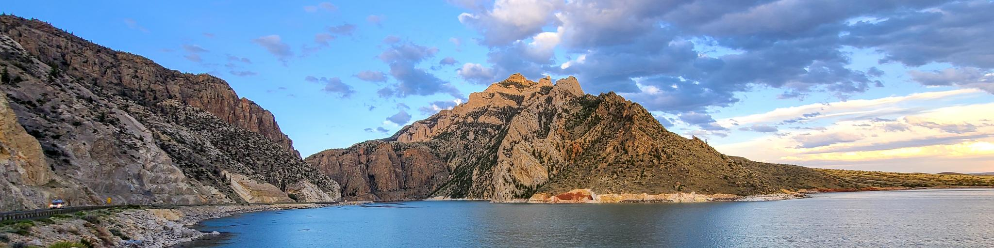 View of a lake and mountain on the approach to the East Entrance to Yellowstone National Park, Wyoming.